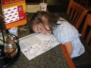 Julianna asleep at Pizza Hut in Hannibal