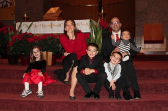 The annual family Christmas shot, taken after Mass. Another one of those pictures that tells you everything you need to know about our family at this point in time: Miss Independent off on her own, Nicholas being cheesy, and Michael trying his utmost to get free. :)