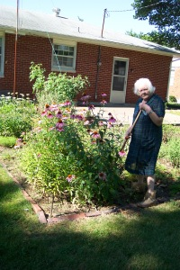 Grandma, in her garden in 2003. To say this woman had a green thumb in her prime is a gross understatement.