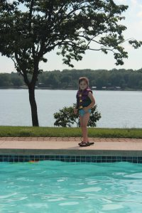 Shoe thief extraordinaire, enjoying the pool at her grandparents' house. The life jacket made my life a whole lot easier.