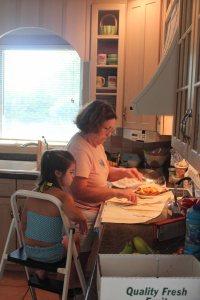 """helping"" Grandma make peach pie."