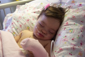 Julianna after heart surgery, age 6 months: Possibly the only time in her life she left a hair bow in her hair.
