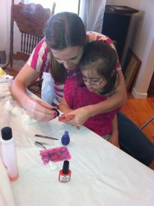 J and Andrea nail painting