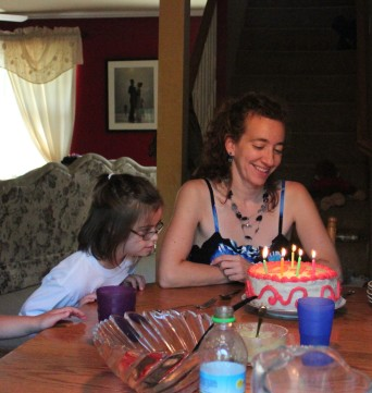 You can tell how serious this girl is about her birthday cakes. Even when they're not for her birthday, but Mommy's.