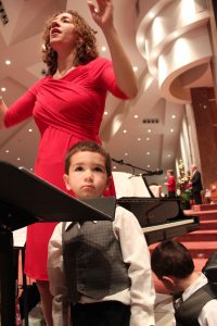 Conducting at Christmas Eve, with two little boys sitting on the podium with me, tickling my legs, brings a whole new perspective to multitasking.